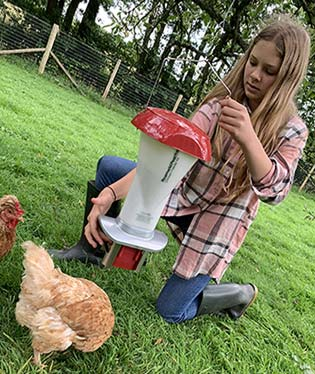 Girl with Rat Proof Feeder