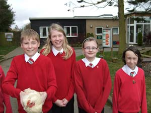 The children with a chicken