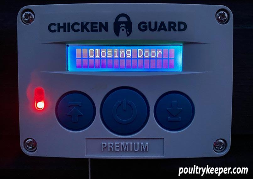 Chicken Guard Closing Door at Night